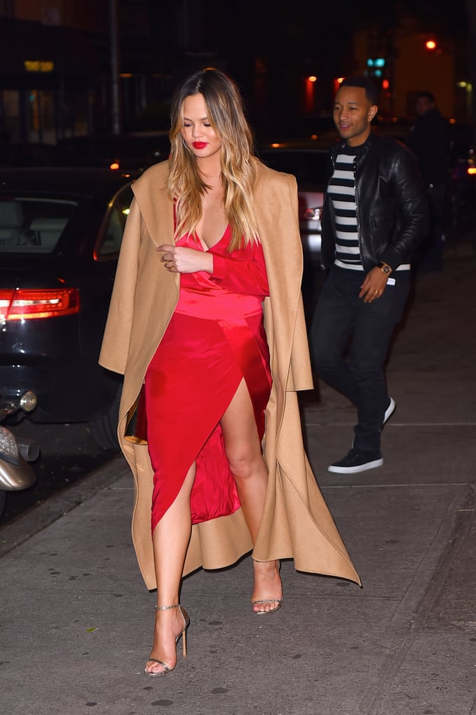 Chrissy chose a colorful wrap dress for her dinner date with John at Carbone Restaurant in NYC. Meanwhile, John was casual in a striped t-shirt and leather jacket.