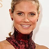 Heidi Klum is obviously an old pro at this red carpet thing, wearing a sleek ponytail and a simple makeup palette (leaving the real excitement in her Versace dress).