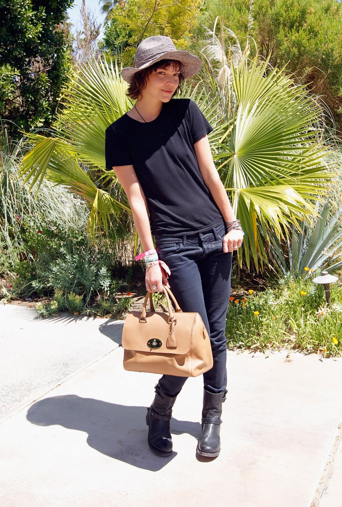 Arizona Muse kept it simple in a black tee and jeans — and Mulberry bag in hand at Mulberry's poolside party.
