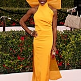 Sola Bamis in a sleek daffodil yellow gown.