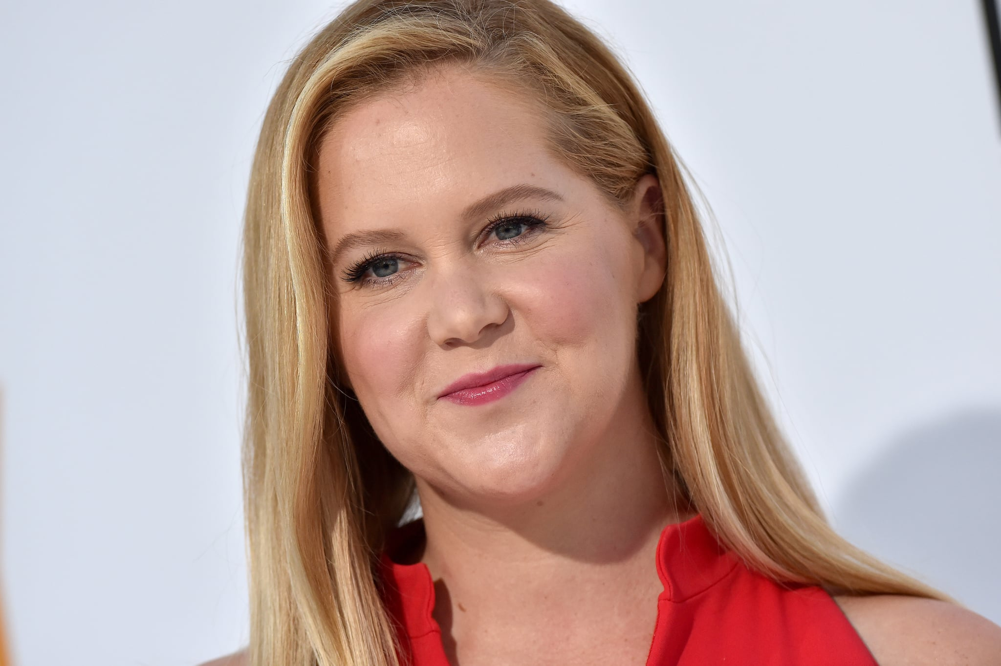 WESTWOOD, CA - APRIL 17:  Actress Amy Schumer arrives at the premiere of STX Films' 'I Feel Pretty' at Westwood Village Theatre on April 17, 2018 in Westwood, California.  (Photo by Axelle/Bauer-Griffin/FilmMagic)