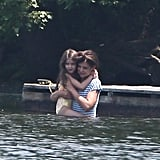 Katie Holmes carried Suri Cruise through the water in a pond in Kent, CT.
