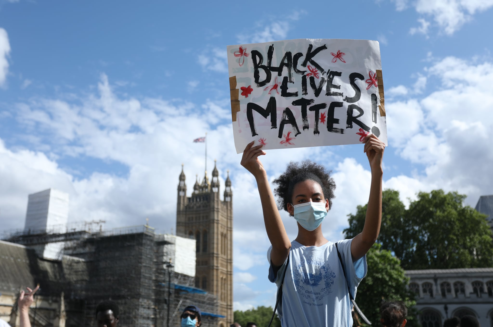 LONDON, UNITED KINGDOM - JUNE 21: A protester with a âBlack Lives Matter' placard stands opposite the Houses of Parliament following a march through central London, United Kingdom on June 21, 2020. (Photo by Isabel Infantes/Anadolu Agency via Getty Images)