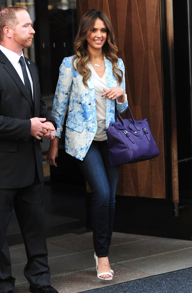 While in NYC, Tibi Daisies blazer ($595), white Aldo Rise x Preen white ankle-strap sandals, and a purple bag.