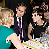 Anne Hathaway chatted with other partygoers.
