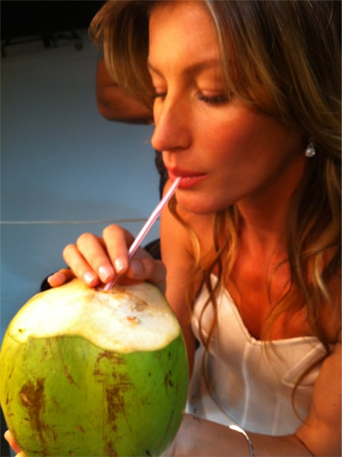 Gisele Bundchen chilled in Brazil and drank from a coconut.  Source: Twitter user giseleofficial