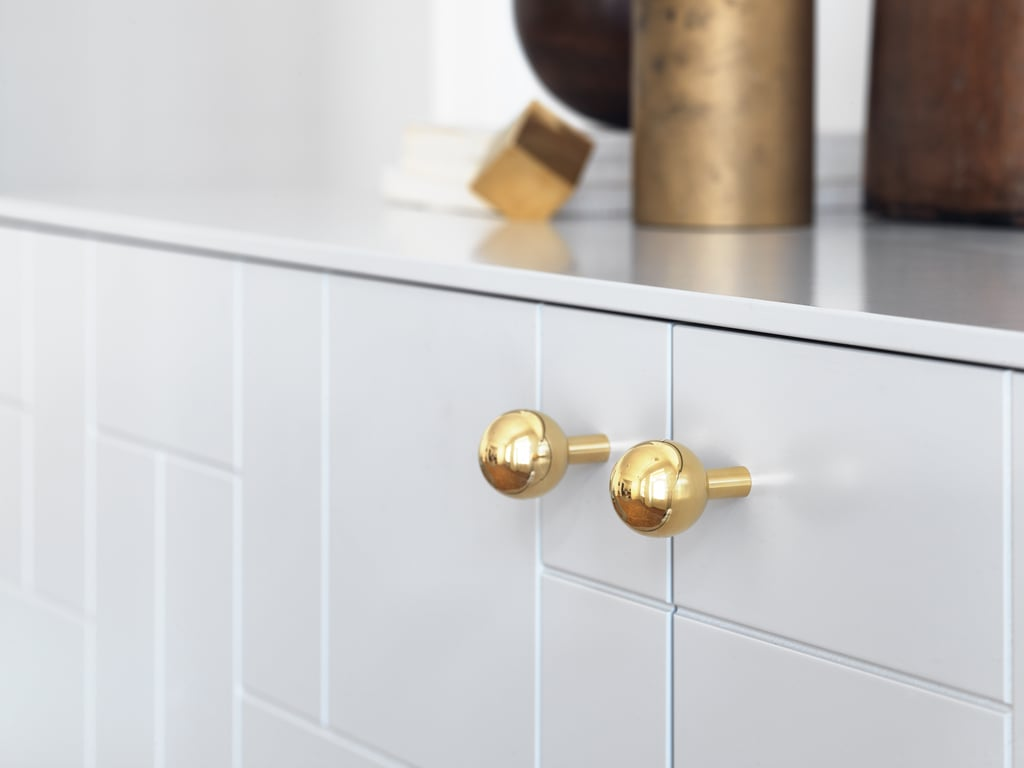 """Born says she created Superfront to offer people timeless design at reasonable prices. """"Since Ikea's cabinet foundations, like the Besta sideboard for example, have great quality these days, we thought it was an excellent idea to build our design around them,"""" she explains.  Pictured: Pluto handles ($22)"""