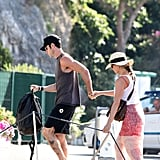 In Italy, Justin Theroux guided Jennifer Aniston off a yacht after a romantic day in June.