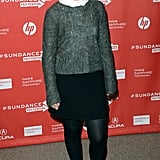 Mia Wasikowska sported this Joe's grey sweater over a white Peter Pan-collar blouse, then completed her preppy outfit with a black miniskirt, black tights, and boots.