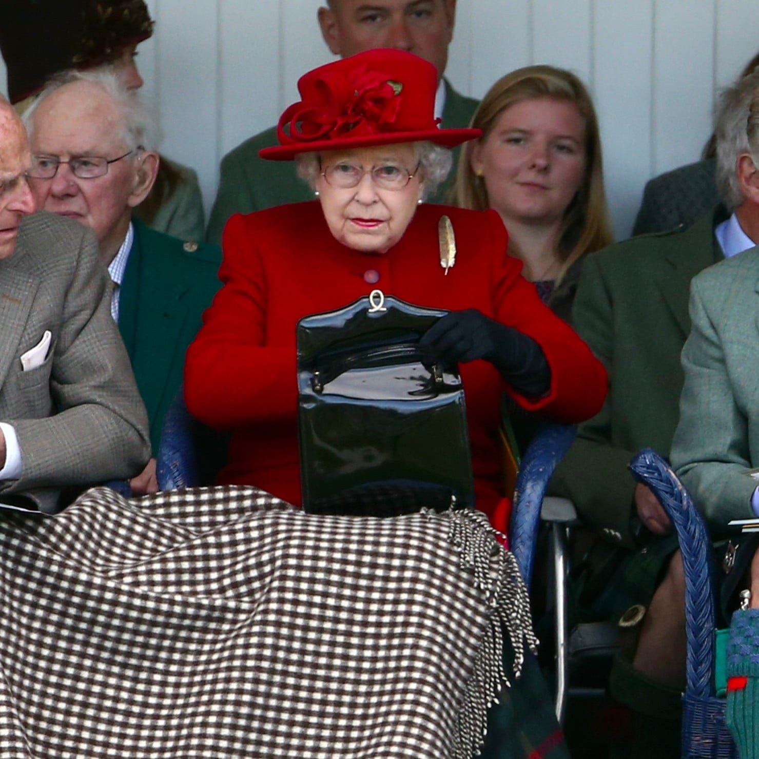 77c244f79798 What Does Queen Elizabeth II Carry in Her Purse