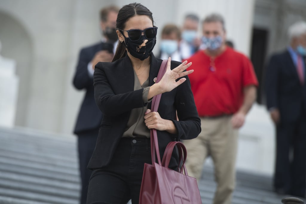 Alexandria Ocasio-Cortez Carrying Red Telfar Shopping Tote