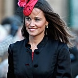 Pippa Middleton wore a pretty red and black — complete with netted veil — fascinator to a wedding in February 2011.