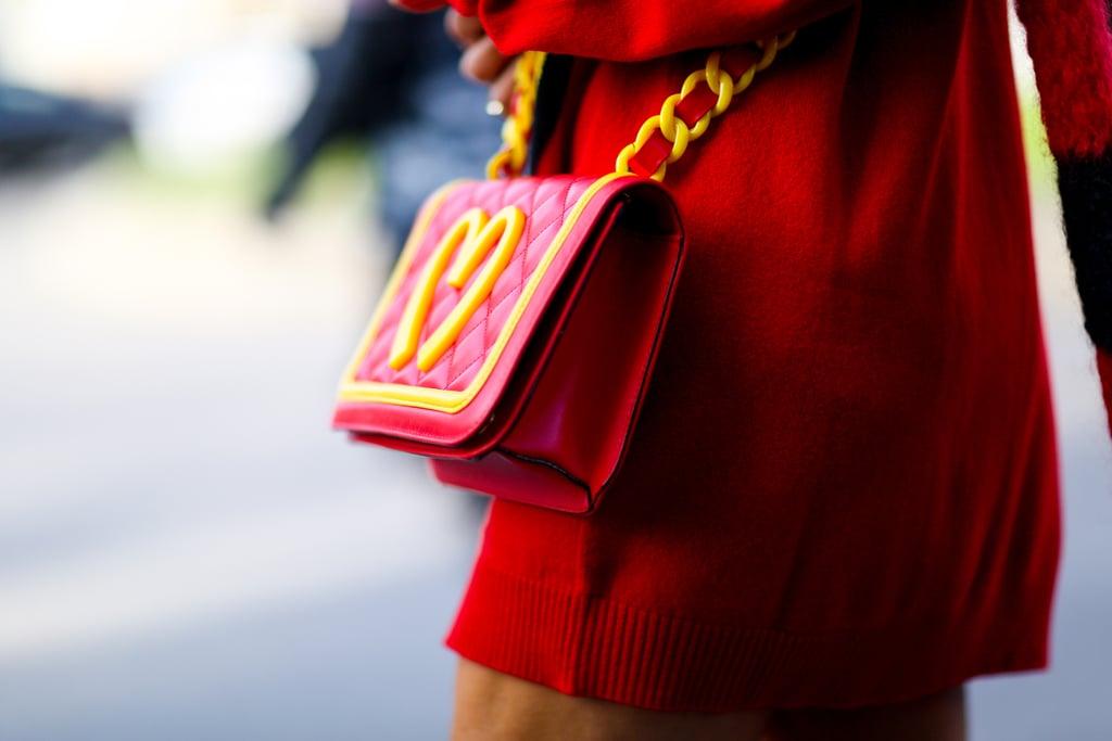 Anna Dello Russo was lovin' it — her Moschino crossbody bag, that is.