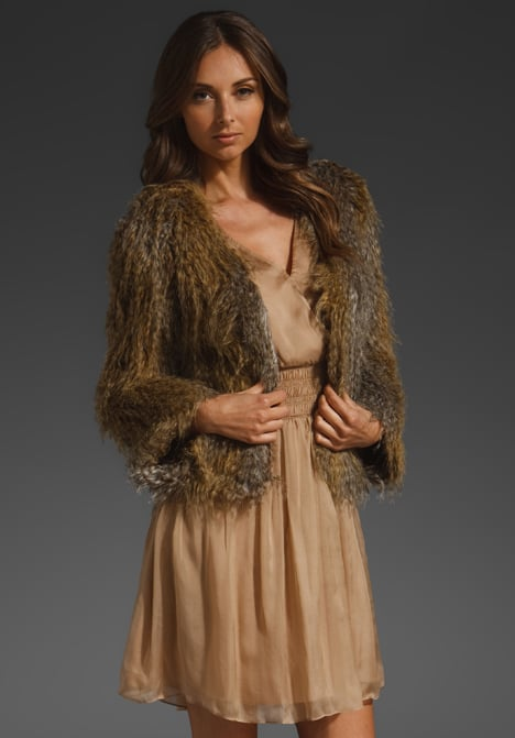 Add extra warmth and a luxurious finish with this faux fur topper.  Halston Heritage Fur Coat ($375)