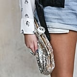 This glittering clutch lent an extra-special vibe to denim cutoffs.