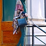 She Used Her Teal Denim and a Cozy Scarf to Play Up the Plaid in Her Poncho