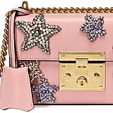 This Gucci Padlock Embroidered Shoulder Bag ($2,890) comes in a pretty millennial pink hue.