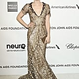 Emma oozed Old Hollywood glamour in an ornate Oscar de la Renta gown in February 2013.