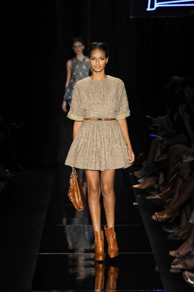 Neutral-hued booties elongate legs and toughen up a sweet day dress just a tad at Triton.