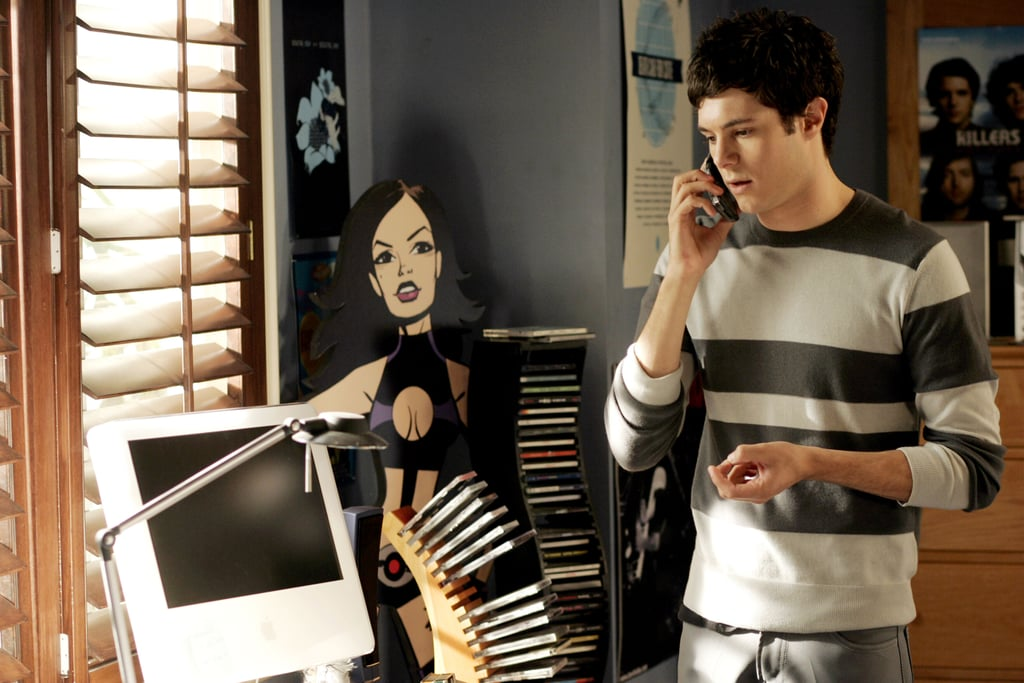 A comic book theme and grey color palette set the tone in Seth's bedroom. We're loving the sexy cartoon babe cutout – and what aughts teen doesn't remember the stacks of CDs and clunky desktop computer?