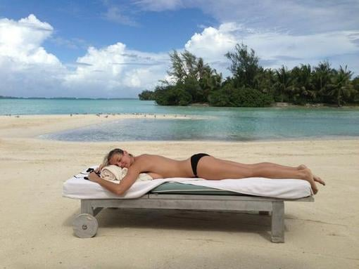 Heidi Klum sunbathed topless on the beach. Source: Twitter user heidiklum