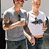 Adam Levine wore an LA Dodgers hat while walking with Behati Prinsloo.