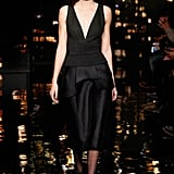 She Walked the Runway at Donna Karan in a Structured Black Dress With a Plunging Neckline
