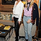 Kate wore black waxed skinny jeans, a lightweight chiffon blouse, and a military-inspired Alice + Olivia blazer. She finished her outfit with lace-up suede booties. Chloë showed off light-wash cropped flares and lace-up platform boots, and she contrasted her lavender Gucci top with a cable-knit cardigan.