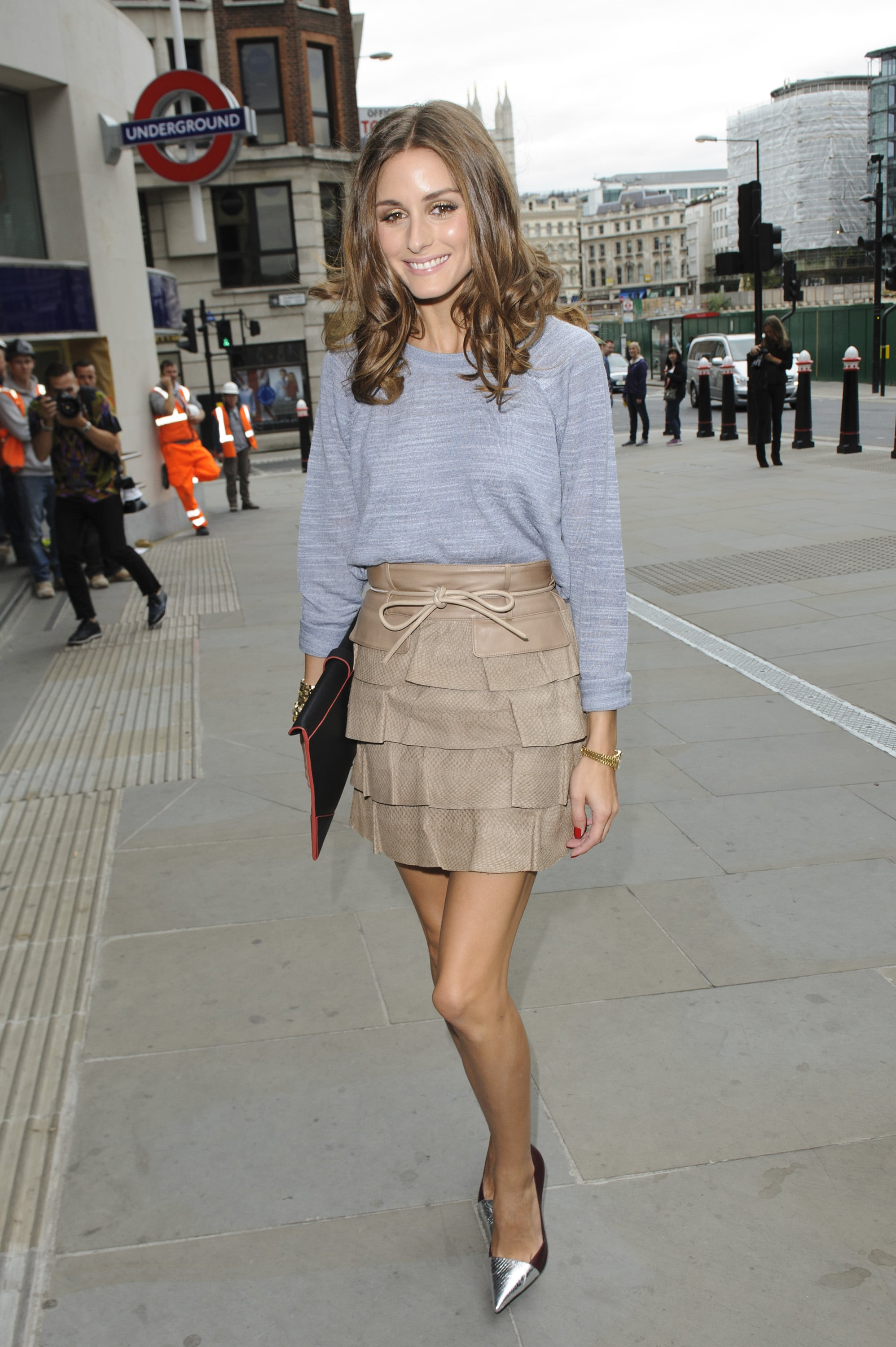 Olivia Palermo gave a Reiss basic knit a fashion-forward twist with a tiered Matthew Williamson miniskirt and a pair of metallic cap-toe pumps by Elizabeth and James at the Matthew Williamson show in London.