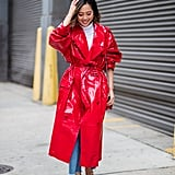 With a White Turtleneck Sweater, a Bright Red PVC Trench Coat, and Ruby Heels