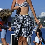 Gwen was snapped at a 1989 beach party while performing with No Doubt in a printed bra top, shorts, and socks.