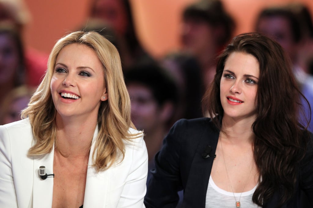 """Kristen Stewart and Charlize Theron sat side by side for an interview about Snow White and the Huntsman on the French show Le Grand Journal Wednesday. Charlize shared that she thinks the movie isn't just an action adventure, but that it really """"speaks to women."""" The costars have since taken their press tour to London, where Kristen chatted with Graham Norton yesterday. Kristen and Charlize will continue promotions this weekend and hit the red carpet in the UK on Monday for the premiere.  Charlize brought her son Jackson along for the travels and the duo were seen boarding a private plane out of Paris yesterday. Kristen apparently got confused and hopped on Charlize's jet instead of her own, and later returned to the tarmac to embark on her assigned aircraft."""