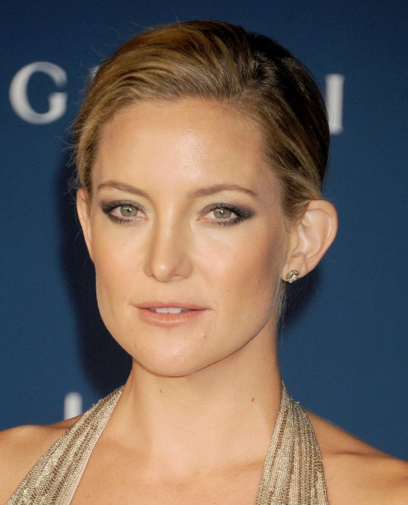 If you're not a fan of the supersleek chignon, then opt for something a little looser like Kate Hudson.