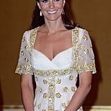 Kate Middleton smiled in her Alexander McQueen dress.