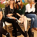 Jennifer Aniston opted for chic all-black separates, alongside Isla Fisher.