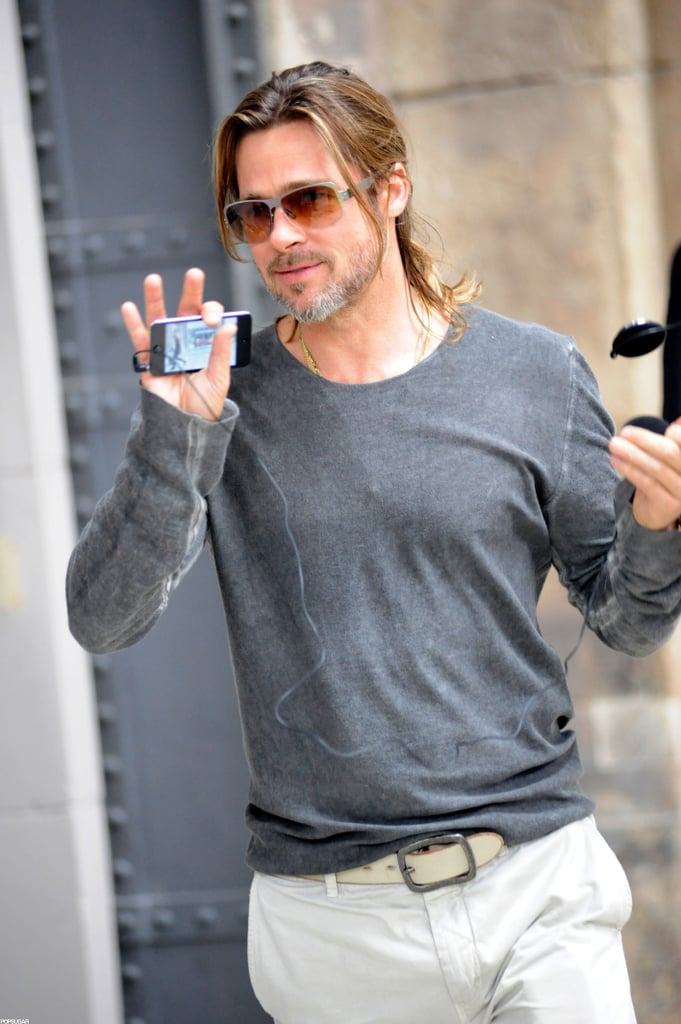 Brad Pitt had his iPhone in hand today as he took a private tour of the Documenta 13 art exhibition in Kassel, Germany. The Documenta event is held once every five years, and Brad, who is a well-known appreciator of art and architecture, stopped by to check out the newest installation during his stay in Europe. Earlier this week, Brad indulged in another one of his passions when he stopped by a Honda motorcycle shop in London. Angelina Jolie is currently filming Disney's Malificent there, and Brad and Angelina are staying in a $16 million home in the Richmond section of the city during their stay in England. Meanwhile, Brad will be completing some unexpected work of his own in the coming months. It was just announced that his zombie film, World War Z, is going through a rewrite that will require new footage to be filmed and potentially change the ending of the movie. Reshoots are expected to begin in September.