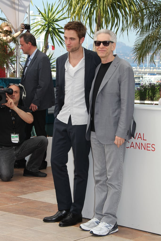 Robert Pattinson linked up with David Cronenberg at the Cosmopolis photocall in Cannes.