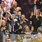 David Beckham held his son Cruz, with brothers Romeo and Brooklyn, at the LA Kings Stanley Cup final game in LA.