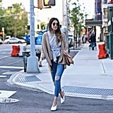 A tie-front top with a cardigan, jeans, and a statement bag.