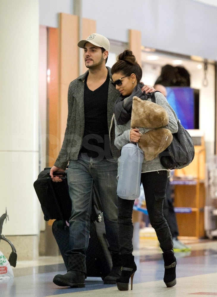 Eva Longoria and boyfriend Eduardo Cruz were together to catch a Qantas flight out of LAX last night. They're frequently on the go, whether visiting her friends in Miami or his family in his native Spain. Eva headed out of town following a busy week in LA. She tweeted a picture of herself and costar Felicity Huffman on the Desperate Housewives set, as well as images from an event with First Lady Michelle Obama on Wednesday. In addition, Eva shot a new ad for L'Oreal's Preference last Saturday. Eduardo, meanwhile, is busy with a project of his own. He wrote on Twitter about focusing on electronic music.