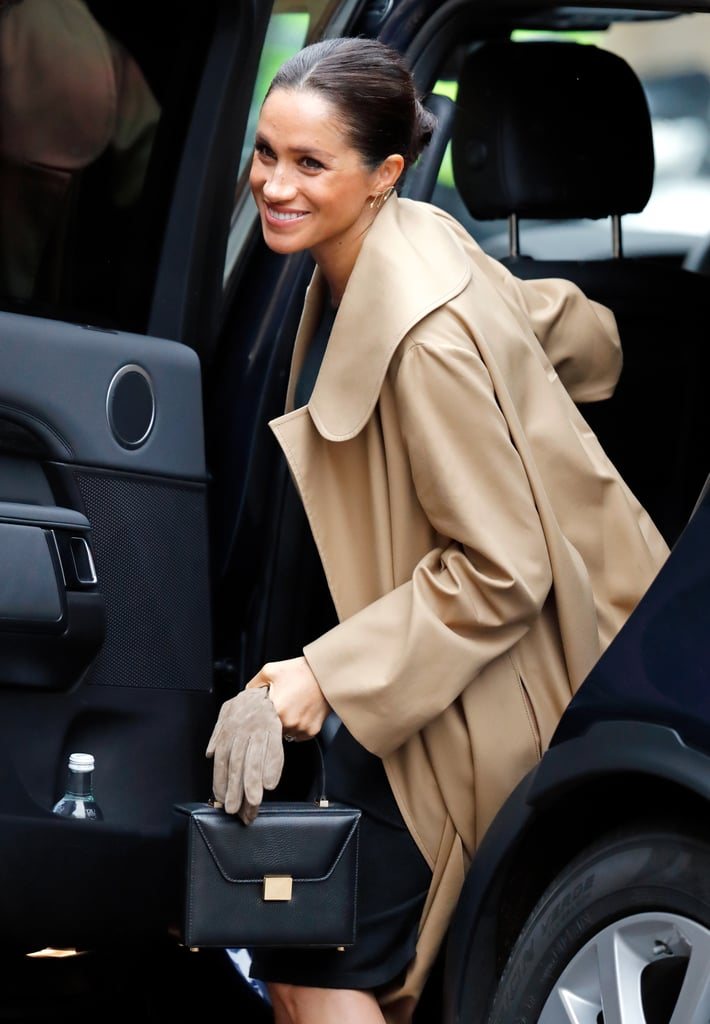 ‎Meghan Markle Carrying a Victoria  Beckham Vanity Top Handle Box Bag in Black