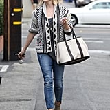 Channeling her inner boho in an aztec-print cardigan, light-wash skimmers, and nude ankle boots.