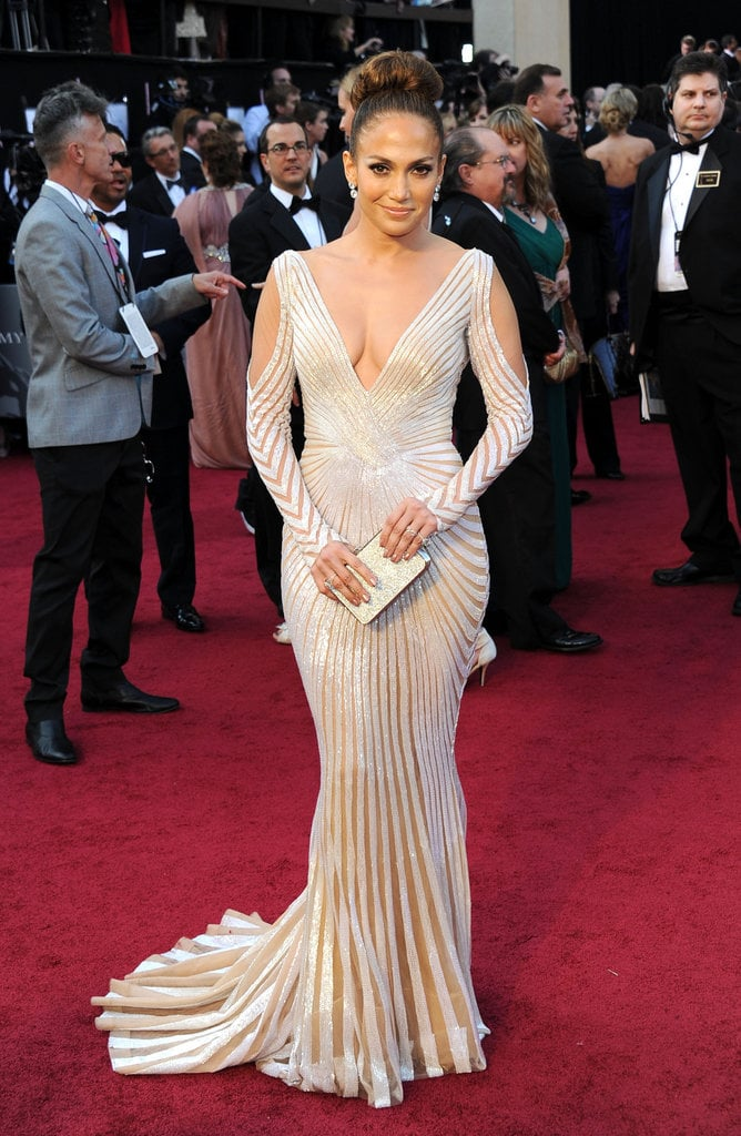 Jennifer Lopez turned up the sexy on the red carpet with a serious dose of sultry from Zuhair Murad. Notice the low neckline — and backline — and revealing arm cut-outs, not to mention sheer insets throughout.