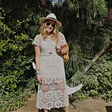 A crochet dress is nice, but this Forever 21 design is stitched with flowers, which takes this look one step further. Grace Hitchcock, Senior Audience Development Associate at Popsugar, rocked it with easy accessories such as a hat, taupe booties, a gemstone pendant, and backpack.