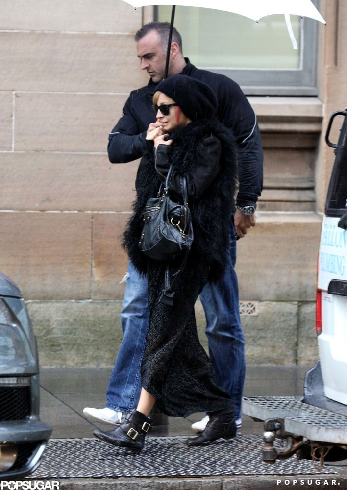 """Nicole Richie was spotted sipping her morning coffee in Australia yesterday. While Down Under, she switched up her style —Nicole Richie dyed part of her hair pink, and shared a picture of her locks with the caption """"tickled pink."""" A colored lock was visible later on when she left her hotel in a shaggy jacket. Nicole's not the only one debuting a new hairstyle. She joked about husband Joel Madden's current tiger-striped 'do on Twitter as well. Nicole has been spending much of her time in Oz with Joel, who is a mentor on the Australian version of The Voice. She did, however, return to the States at the end of last month for the FiFi Awards. Nicole got dressed up in an Emilio Pucci number for the annual event in NYC."""