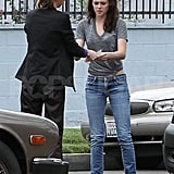Kristen Stewart exchanges insurance information.