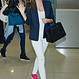 Miranda Kerr waved to fans after touching down at the airport in South Korea on Monday.