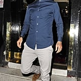 David Beckham wore a hat and a blue button-down for a night out in London.