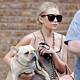 Ashley Olsen left her NYC apartment with her French bulldog.