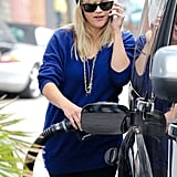 Reese Witherspoon Multitasks at the Gas Pump